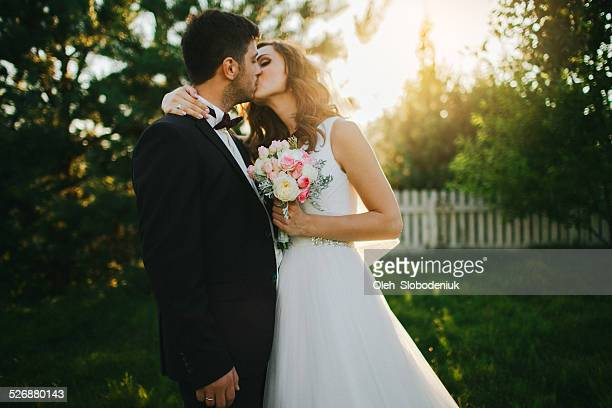 couple in garden - kissing stock pictures, royalty-free photos & images