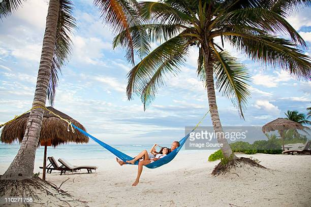 couple in hammock on vacation - mexico stock photos and pictures
