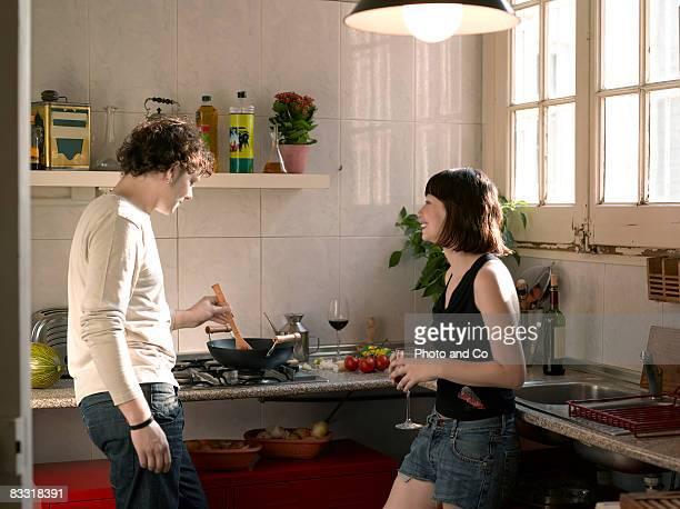 couple in her kitchen - two people imagens e fotografias de stock