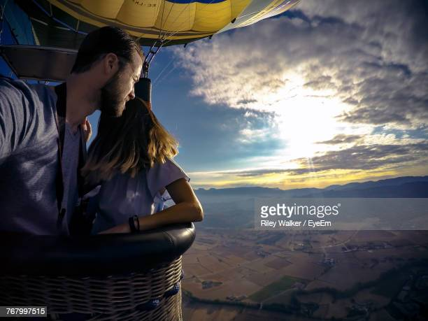 couple in hot air balloon - balloon ride stock pictures, royalty-free photos & images
