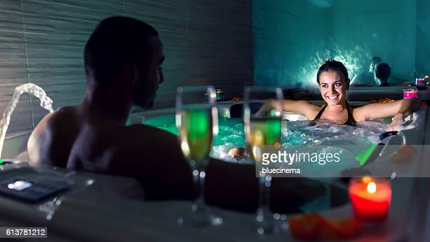 couple in hot tub pool - couple bathtub stock pictures, royalty-free photos & images