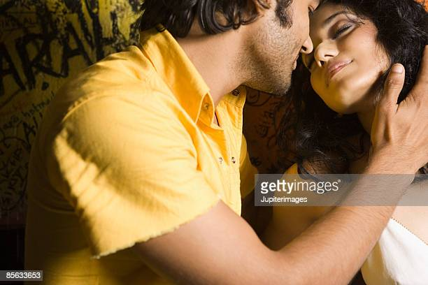 Couple in intimate pose in nightclub