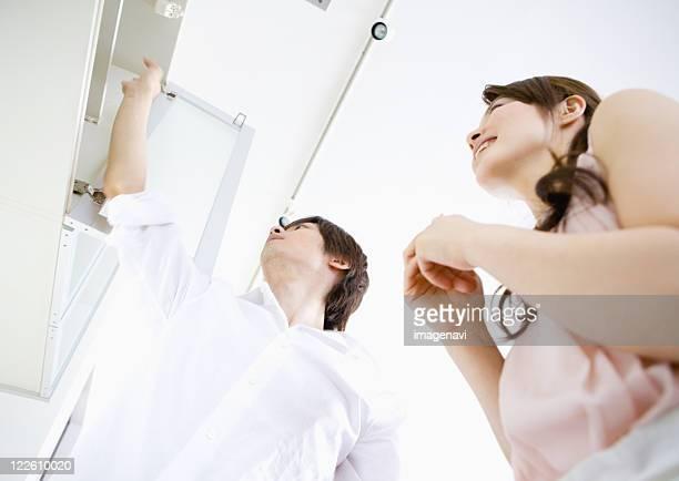 couple in kitchen - open blouse fotografías e imágenes de stock