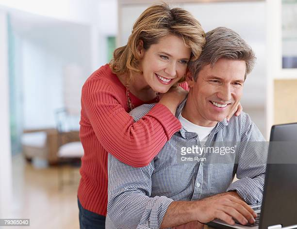 Couple in kitchen with laptop