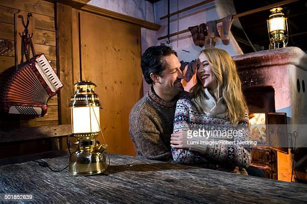 Couple In Log Cabin, Tyrol, Austria, Europe