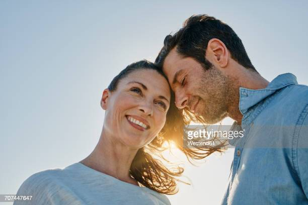 Couple in love at backlight