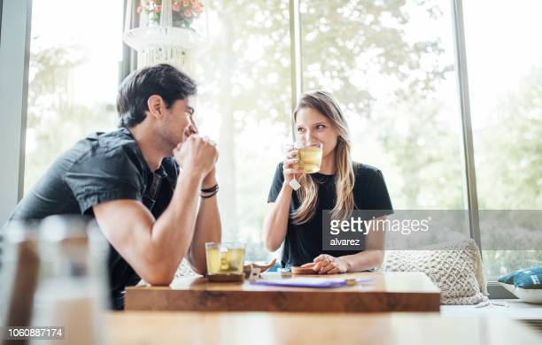 couple in love at cafe - refreshment stock pictures, royalty-free photos & images