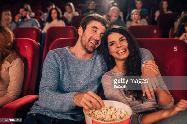 couple in love at cinema - comedy film stock photos and pictures