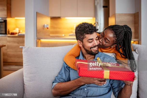 couple in love celebrating birthday - receiving stock pictures, royalty-free photos & images