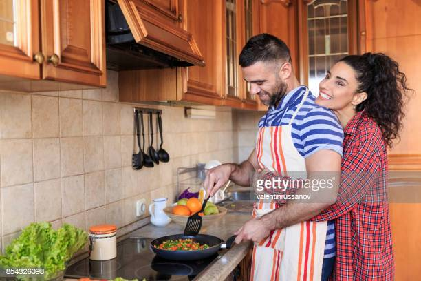 Couple in love cooking at home