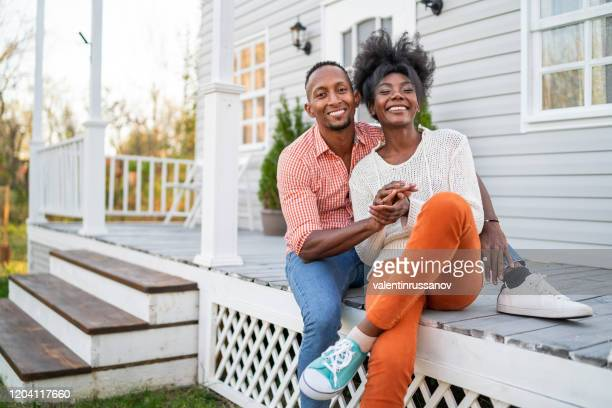 couple in love hanging out on the porch - home ownership stock pictures, royalty-free photos & images