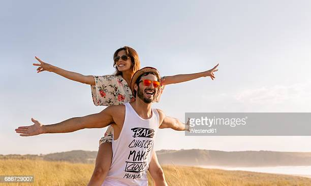 couple in love having fun near the coast - arms outstretched stock pictures, royalty-free photos & images