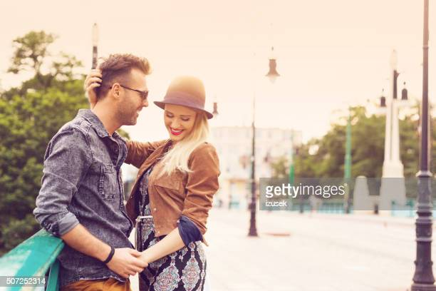 Couple in love in the city at sunset, outdoor portrait