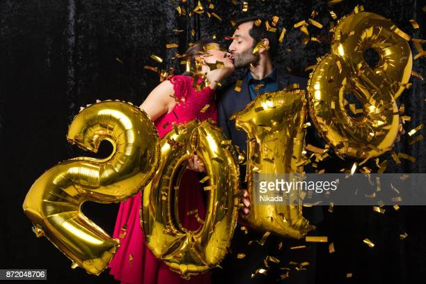 Couple in Love Kissing at New Year's Eve party