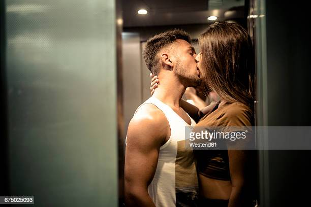 Couple in love kissing in elevator