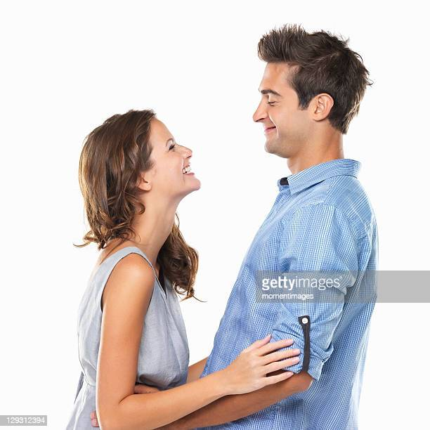 Couple in love looking at each other and smiling