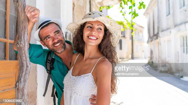 couple in love on the street in old town volimes in zakynthos greece - smurfs: the lost village stock pictures, royalty-free photos & images