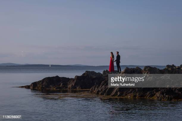 couple in love - rocky coastline stock pictures, royalty-free photos & images