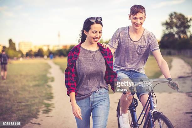 Couple in love riding through a berlin public park