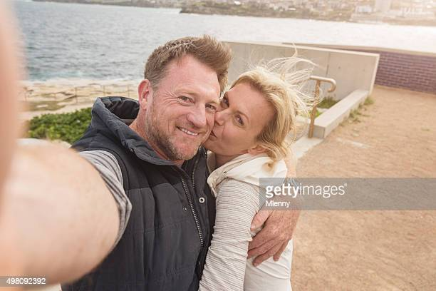 Couple in Love Taking Selfie Kissing Bondi Beach Australia