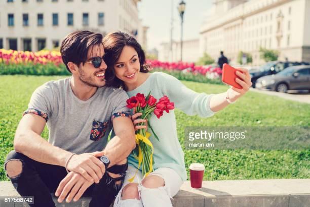 Couple in love taking selfie outside