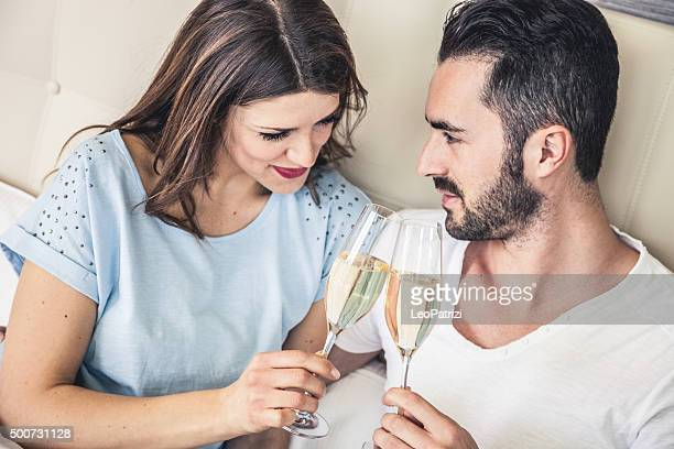Couple in love toasting in the bed