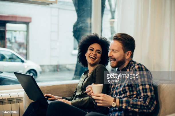 Couple in love using laptop and smiling