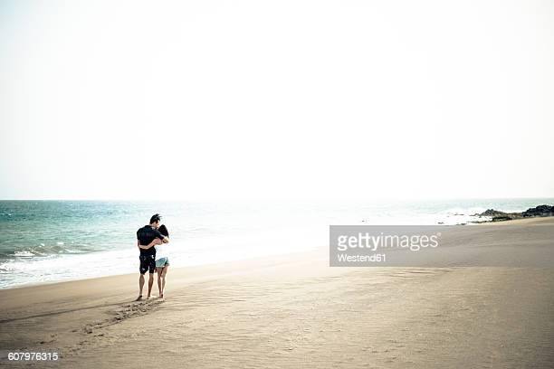 Couple in love walking on the beach