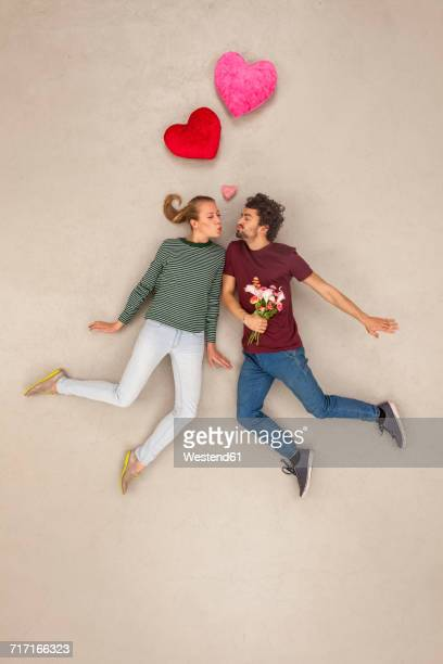 Couple in love with a bunch of flowers