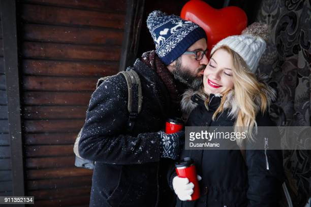 couple in love with balloons - winter day of st. valentine - heart month stock photos and pictures