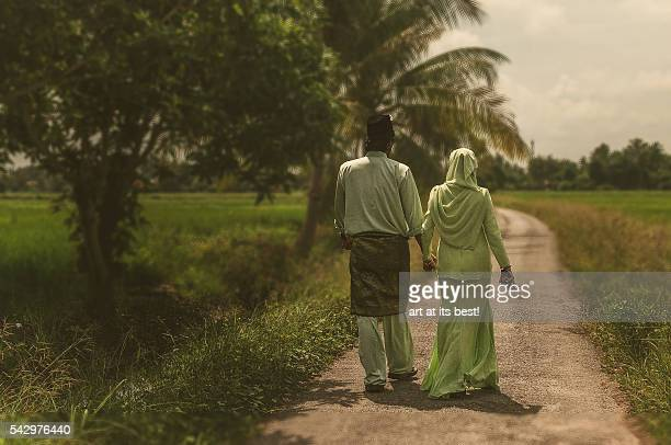 Couple in Malay traditional clothing.