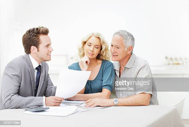 Couple in meeting with financial adviser