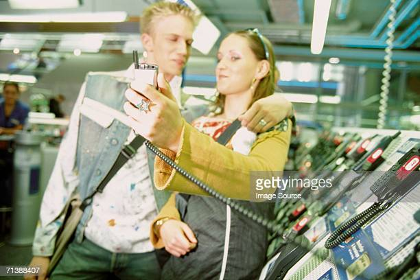 Couple in mobile phone shop