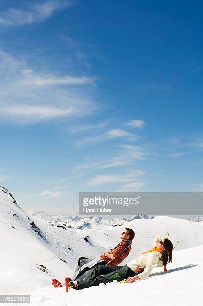 Young couple on mountains, side view