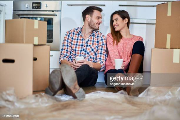 couple in new apartment - house rental stock pictures, royalty-free photos & images