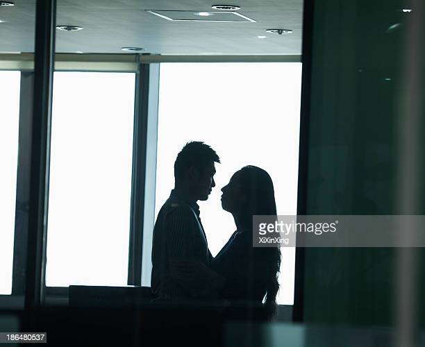 couple in office - work romance stock pictures, royalty-free photos & images