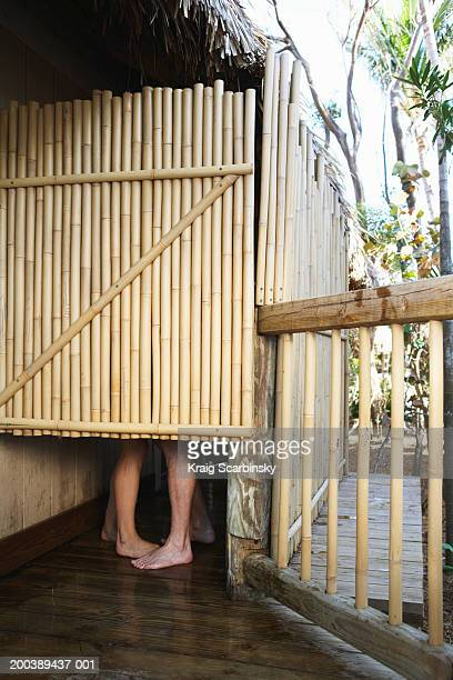 couple in outdoor shower - couples showering together stock photos and pictures