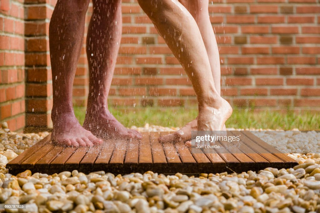 Couple in outdoor shower : Stock Photo