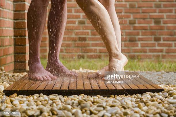 couple in outdoor shower - couples showering stock pictures, royalty-free photos & images
