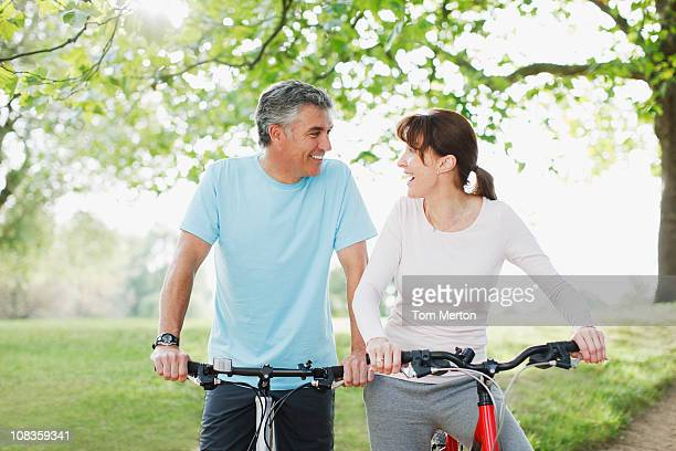 Couple in park riding bicycles