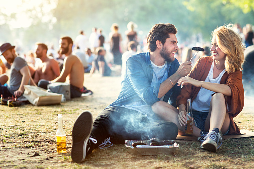 Couple in park using barbecue - gettyimageskorea