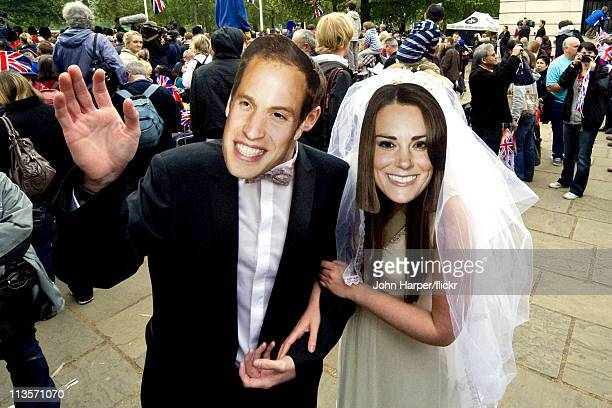 Couple in Prince William and Catherine Middleton masks are seen on the Mall during the Royal Wedding of Prince William and Catherine Middleton on...