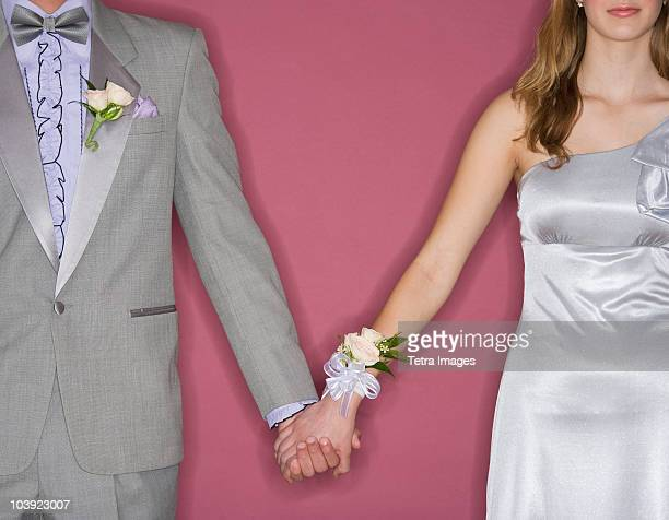 couple in prom attire holding hands - prom stock pictures, royalty-free photos & images