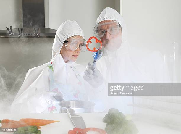 Couple in protective suits cooking