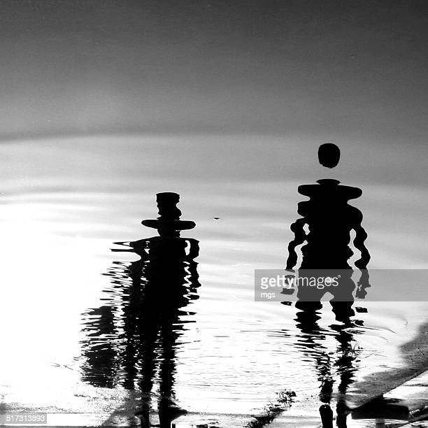 Couple in puddle