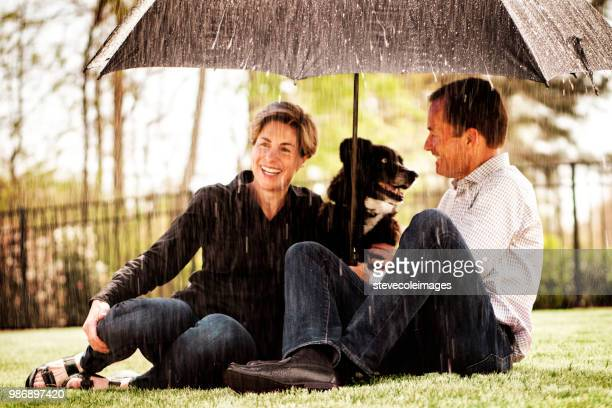 Couple in Rain with Dog