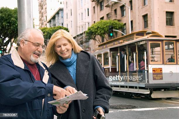Couple in San Francisco with streetcar in background