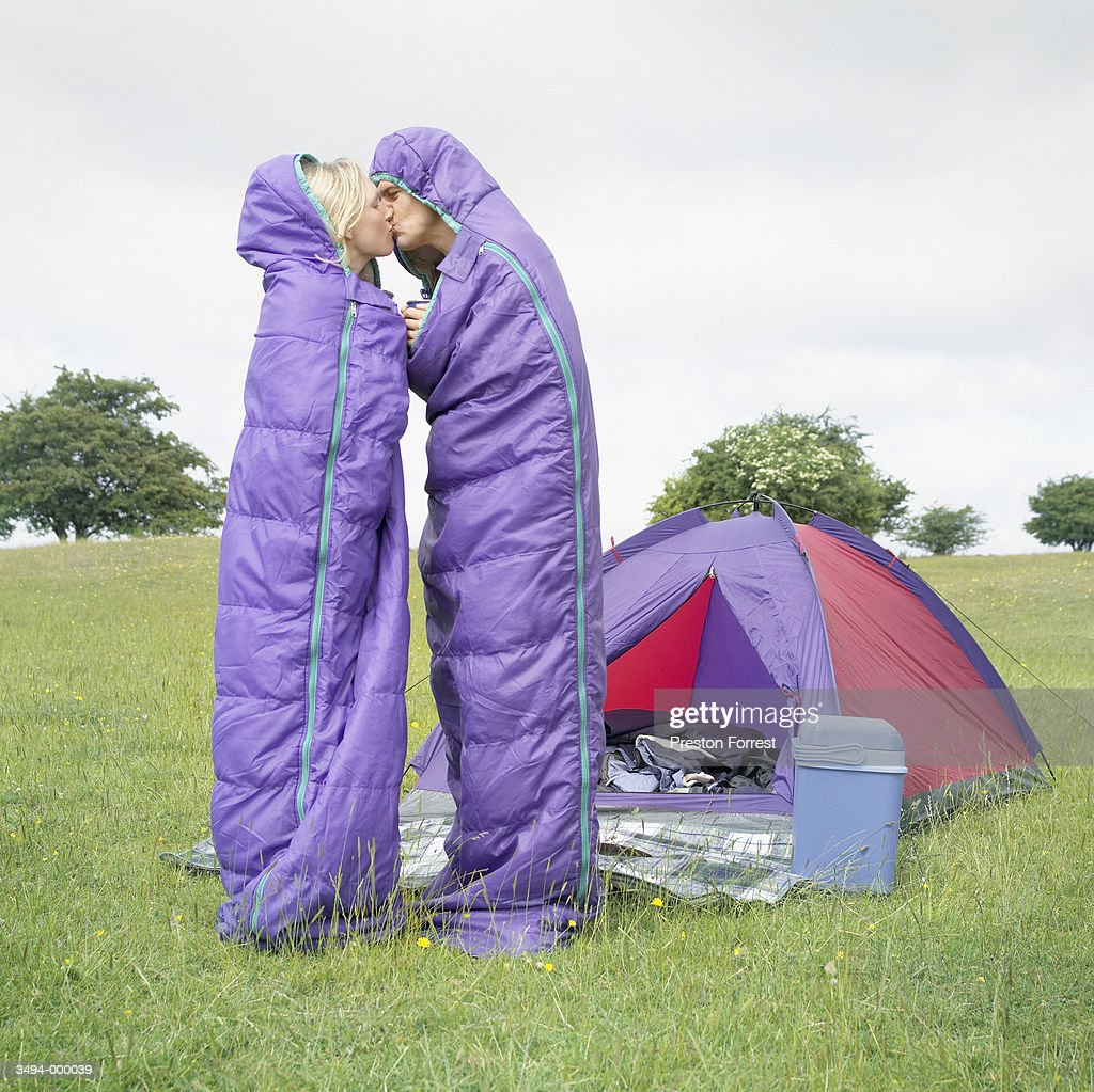 Couple in Sleeping Bags Kiss : Stock Photo