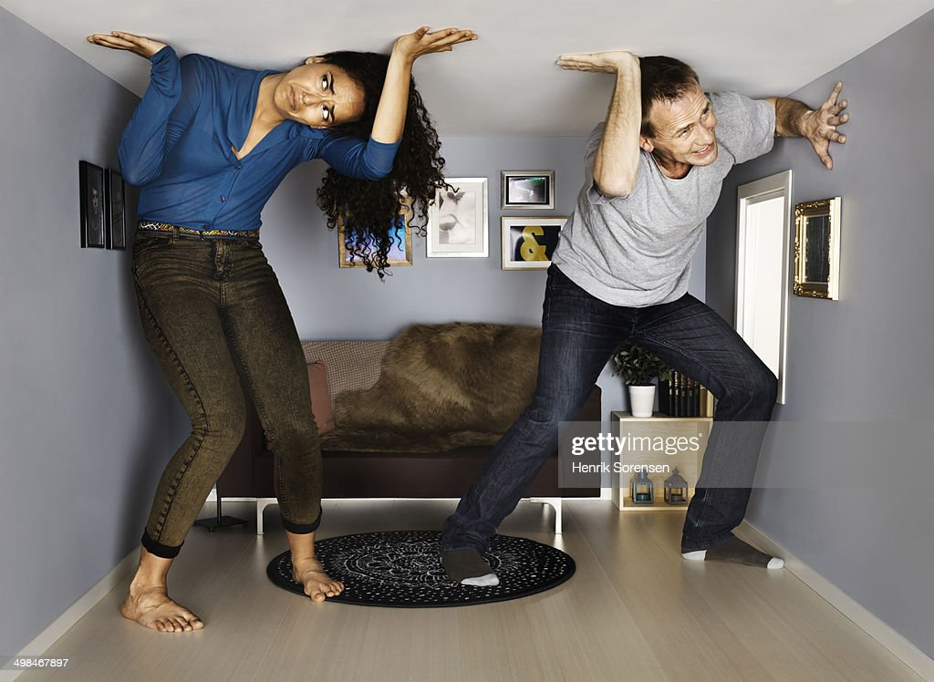 couple in small scale living room : Stock Photo