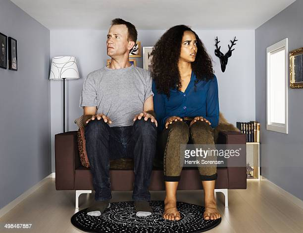 couple in smallscale living room - trapped stock pictures, royalty-free photos & images